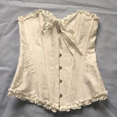 White Corset Small I only wore this corset once for a party. It is a size small and has a back lace up so you can adjust for size. It has a front metal closure as well. There are no flaws. Intimates & Sleepwear