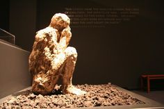 A Day in Pompeii: Cast of a seated man