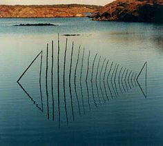 Andy Goldsworthy. By far one of my favorites do to the fact that he very wisely uses the reflection of the water as part of the sculpture.