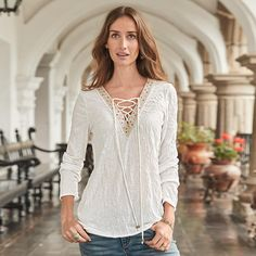 "LEGACY TOP -- A beautiful update to a flattering Sundance favorite. It's all in the details with lace-up front, sequins and elegant embroidery. Neckline tassels, rounded hem. Polyester. Hand wash. Imported. Exclusive. Sizes XS (2), S (4 to 6), M (8 to 10), L (12 to 14), XL (16). Front approx. 25""L."