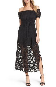 This party-ready off the shoulder maxi dress is elegantly accented with floral lace