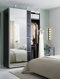 Mirrored wardrobe doors, like AULI for PAX, are clever small space multi-taskers.  They hide your clothes and reflect light to make your room feel larger, all while taking up no extra wall space!