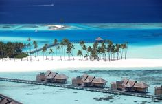 Gili Lankanfushi in the Maldives took the title for the best hotel in the world, and has 45 overwater villas. The resort has a 'no news, no shoes' policy and guests can enjoy private butler service. Best All Inclusive Honeymoon, Honeymoon Places, Vacation Places, Dream Vacations, Vacation Spots, Places To Travel, Places To Visit, Honeymoon Island, Romantic Vacations