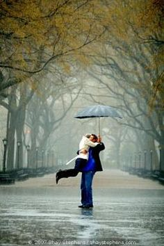 Such a simple proposal idea, but capturing it with the help of a secret photographer makes it totally amazing.  Plus...it's in the rain, and I LOVE walking in the rain.