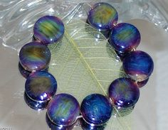 FIRE LOTUS tab lampwork beads. blues and greens by Flameartbytd  ..fire lotus
