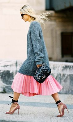 This is the only piece you need for Spring. Needless to say we're loving this pink pleated midi skirt that pairs so well with heels and an oversized sweater..