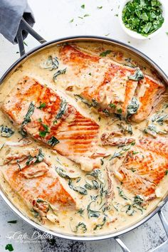 Creamy Garlic Butter Tuscan Salmon (OR TROUT) is such an incredible recipe! Restaurant quality salmon in a beautiful creamy Tuscan sauce! #seafoodrecipes