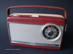 Listening to Radio Luxembourg with a transistor radio.