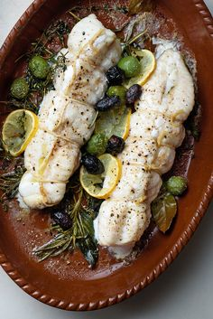 "NYT Cooking: Firm-fleshed fish can be described as ""meaty"" — monkfish fits this category — and are often best roasted in a hot oven. Tart lemon slices, aromatic herbs and olives enhance and complement that meatiness, just as they would roast lamb or chicken. A smear of rustic zesty black olive paste is the perfect condiment to complete this simple dish. Use whatever kind of olives%..."