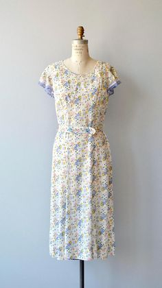 Vintage 1930s lightweight cotton day dress with petite pastel floral print, short sleeves, french blue lace trim and matching belt. --- M E A S U R E M E N T S ---  fits like: small/medium bust: 34-36 waist: unfitted, fits up to 31 hip: 40 length: 45 brand/maker: n/a condition: excellent, slight color variation on the upper back  to ensure a good fit, please read the sizing guide: http://www.etsy.com/shop/DearGolden/policy  ✩ layaway is available for th...