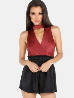 An effortless onesie. Featuring colorblock contrast, choker neckline, back zip…