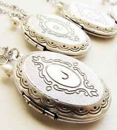 Gorgeous as a necklace or bouquet charm! Oval Locket Initial Necklace by Sora Designs on Scoutmob Shoppe