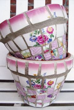 Use tile adhesive to affix pieces of shattered china plates to a basic terracotta flower pot for a one-of-a-kind piece.