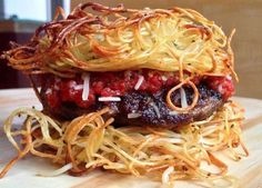 This Burger Replaces the Bun with Fried Spaghetti Noodles #burgers trendhunter.com