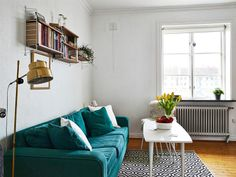 Love the lamp and the teal sofa