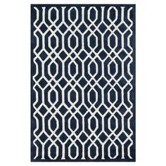 Stylishly anchor your living room seating group or master suite ensemble with this hand-tufted wool rug, showcasing an eye-catching trellis motif.