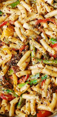 Gluten Free Penne Pasta, Bell Peppers, and Asparagus in a Creamy Sun-Dried Tomato Sauce, with basil and crushed red pepper. The vegetables taste so good with all the spices, pasta, and the flavorful creamy sauce in this Italian pasta dinner!