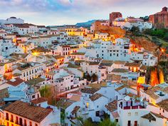 Setenil de las Bodegas Andalusia, Spain The terra-cotta roofs that dot the skyline of the towns known as Pueblos Blancos in Spain's Andalusia region disappear as you enter the small, medieval town of Setenil de las Bodegas