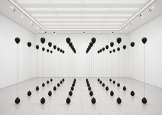 Tadao Cern blows away Black Balloons by using different gases creating sculptural balance in the air