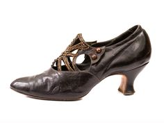 1900-1919  Purple iridescent leather lady's shoe with beaded and cut-out tongue by Derry and Toms