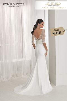 21a243f672b7 Estilo NLOZI TAMMY A strapless crepe sheath dress with an exquisitely beaded  ¾ length sleeved,