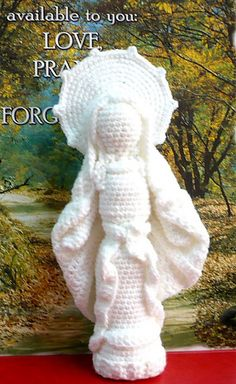 This is a crocheted form/figurine/statuette/sculpture of Virgin Mother Mary aka The Blessed Virgin Mary. She is about 9 inches(22.9 cm) tall and 4.5 inches(11.4 cm) widest.