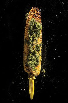 Grilled Corn with Pesto-- Grilled ears of corn take on a smokiness that pairs well with a garlicky pesto.