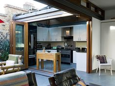 The tightness of this kitchen is mitigated by the tri-fold doors which open it to a small urban courtyard. charming.