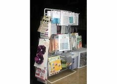 Various embellishments are stored on this display rack.  S hooks hang on the back and sides to hold more items for easy viewing and accessibility.