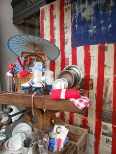 Red White Blue displays...like the flag painted on newspaper for backdrop.