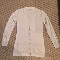 Banana Republic V Neck Sweater, Size Medium, Deep V Neck button down sweater, cream colored, lightly worn. 52% silk, 15% polyester, 13% cotton. Sweater has 2 front pockets and 5 mother of pearl with gold detail buttons. Banana Republic Sweaters V-Necks