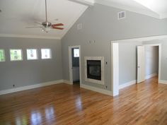 color of wood flooring with grey walls and white trim...not sure if we'll have white trim or the wood color trim.