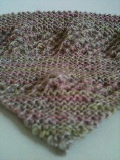 Own design, knitted, triangle shoulder wrap/shawl. I'm using hand spun British sheep fleece from Weave Knit It.
