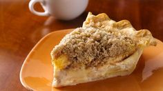 Sour Cream-Apple Pie - Sweetened sour cream swirls around apple slices in this rich pie featuring an easy refrigerated pie crust and quick brown sugar and cinnamon crumble topping.