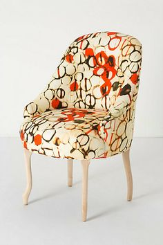 Rustic meets Modern. Painted fabric chair by artist and designer Sherry Olsen for Anthropologie.  Drink-rings on a coffee table was an inspiration.