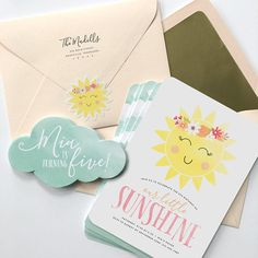 * Free Shipping on all printed orders! (U.S. Only) * These bright and happy sunshine invitations feature our exclusive sunshine illustration with watercolor design elements and hand-drawn inspired text. The back contains a watercolor cloud pattern. Cloud enclosure is optional. (note: