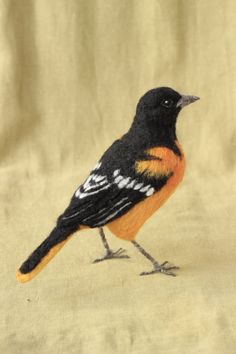 Life sized needle felted Baltimore Oriole by Ainigmati