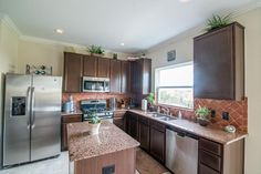 Check out your island kitchen with granite counter tops and tile floor.