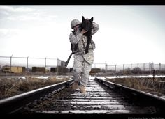 Staff Sgt. Erick Martinez, a military dog handler at Hill Air Force Base, Utah, carries his canine partner Argo II.