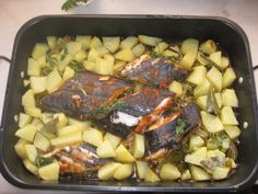 Swordfish  Potatoes  Onion  Garlic  White wine  Half a lemon  Parsley  Salt  Paprika  Olive oil