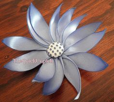 This beautiful ribbon flower can be used to make a broach, a headband, or even used to dress up your gift wrapping in place of a traditional bow. Description from tipjunkie.com. I searched for this on bing.com/images
