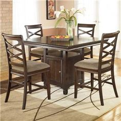 Hayley Counter Height Dining Table - love the criss-cross chair backs. We have the extension table on our floor. -by Ashley Furniture-(kitchen table) Pub Dining Set, Dining Room Sets, Dining Room Table, Dining Area, Kitchen Tables, Pub Tables, Dining Stools, Bar Stools, Kitchen Ideas