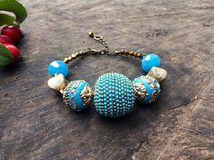 This is a statement bracelet in gold and turquoise colors. It is a striking piece, that can be worn day or night. All my items are boxed as gifts. The length of the bracelet is 19cm/ 7.4inches to 23cm/9inches. The diameter of the central and largest bead is 2cm/0.78inches.
