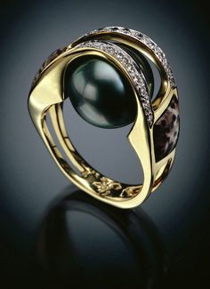 My favorite jewelry designer, Randy Polk - check out this Tahitian black Pearls w/petrified palm & inlaid Diamonds Pearl Jewelry, Jewelry Art, Jewelry Rings, Jewelry Accessories, Fine Jewelry, Unique Jewelry, Pearl Rings, Women's Rings, Pearl Bracelets