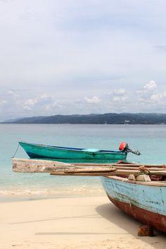 Boats of local fishermen in Cayo Levantado