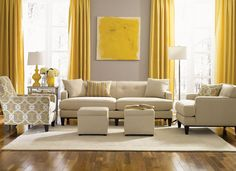 Beige couch, grey walls, yellow accents