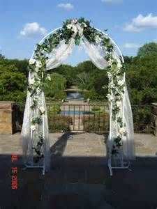 A golf course wedding arch with tulle draping and orange flower metal wedding arches bing images junglespirit Images