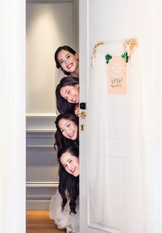 Cute morning shot with the bride and bridesmaids peeking out! | Glamourous Bridal Prep Inspiration, Old Hollywood Style