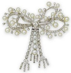 An early 20th century cultured pearl and diamond bow brooch