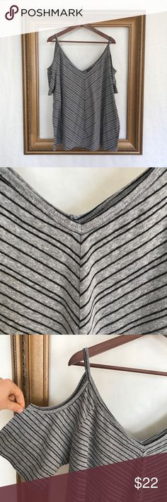 Torrid Gray striped cold shoulder SS swing tee In excellent used condition. EUC. Swing tee. Shirt blouse top. Basic. On trend. V neck. 25 inches armpit to armpit. 29 inches shoulder to bottom of shirt. torrid Tops Tees - Short Sleeve